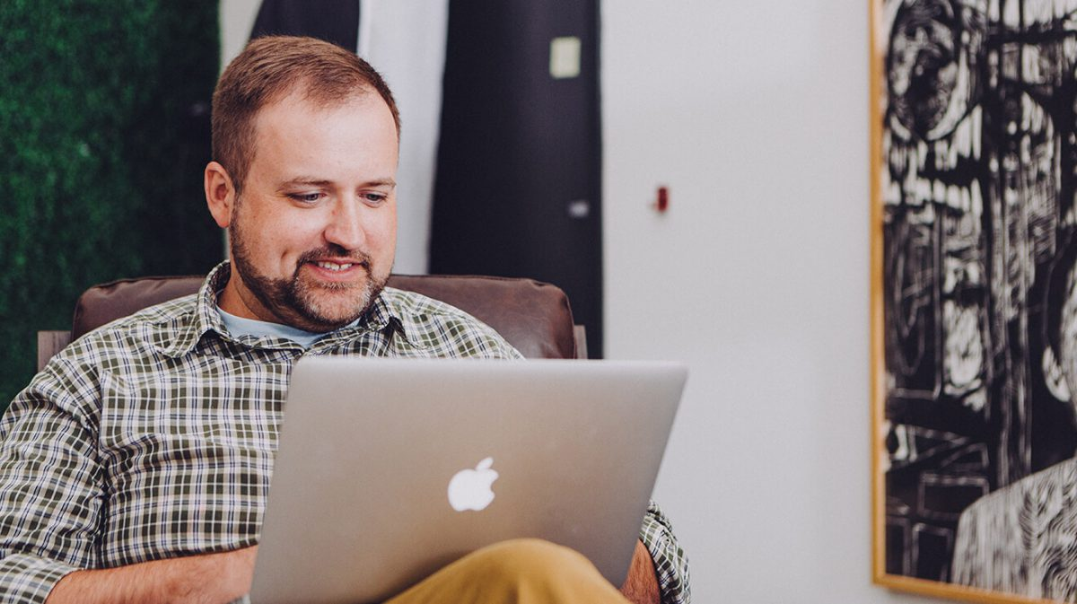 Man Watching Educational Video Content