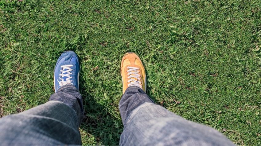 Person with two different colored shoes on