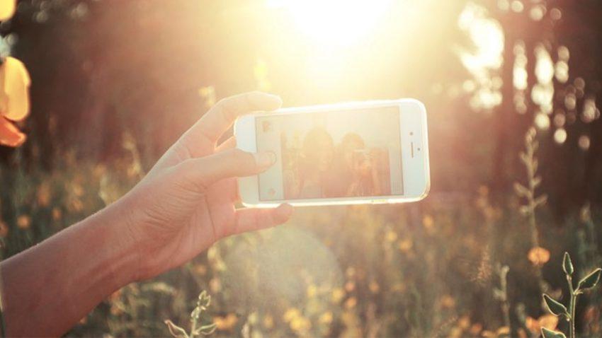 Two people taking selfie