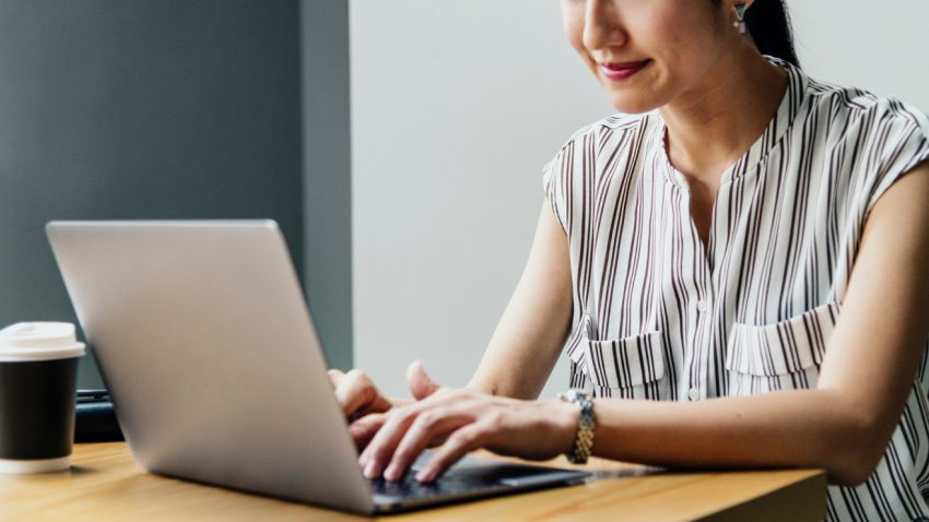 Woman using a laptop for marketing videos